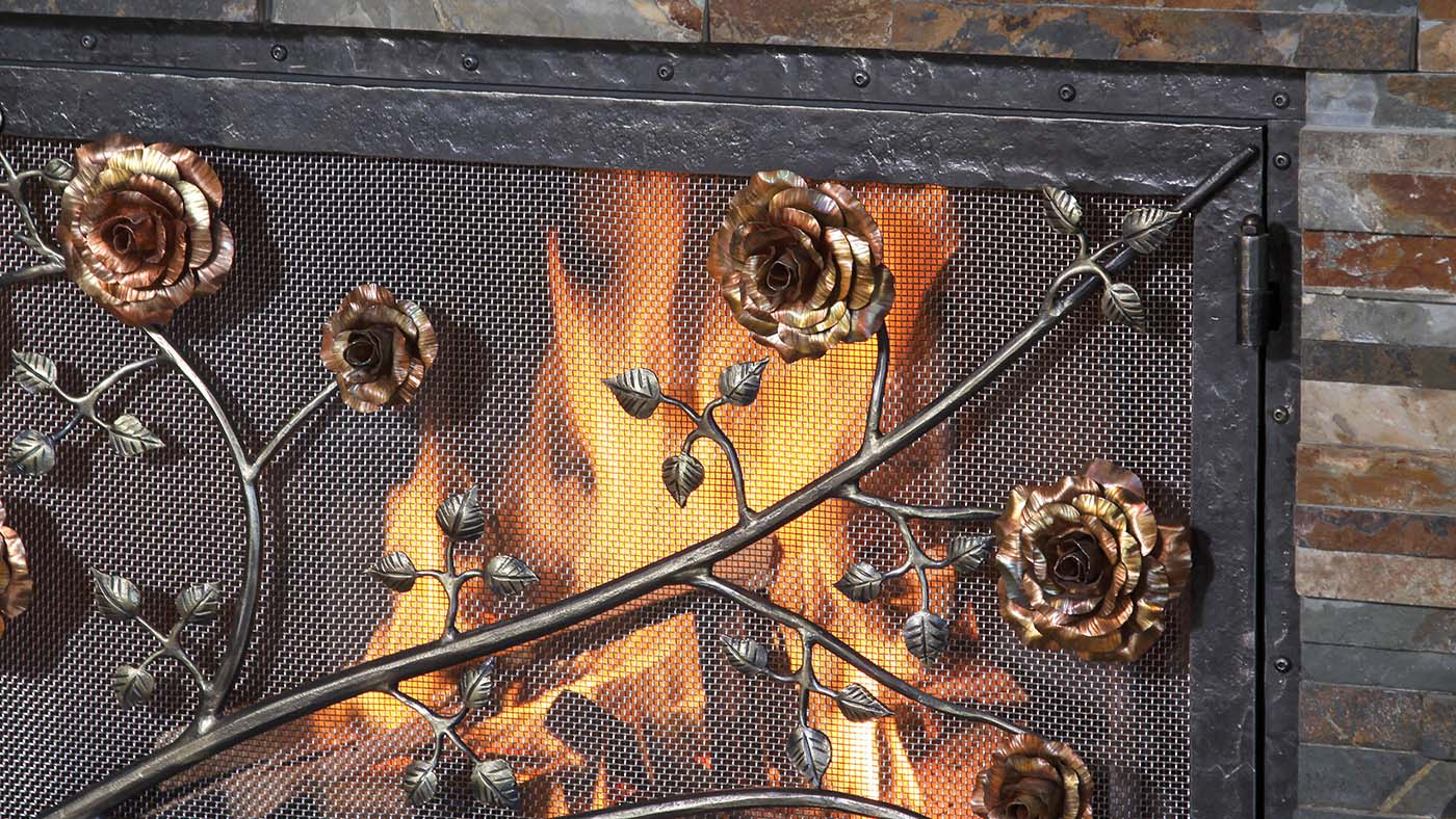 iron forged fireplace screen with metal rose flowers