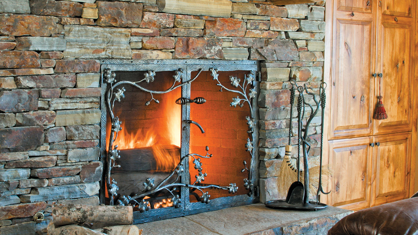 metal fireplace screen with oak leaves and branches